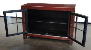 red small cabinet with glass doors na041