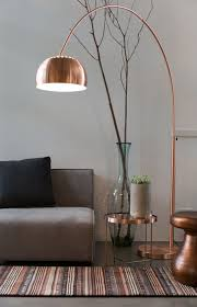 Living Room With Grey Walls And Sofa Also Copper Arc Floor Lamp In