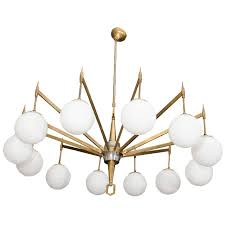 arm brass chandelier with white opaque globes by coolhouse home design choose the best lighting