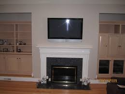 mount tv over fireplace. Full Size Of Mount Tv On Brick Wall Hide Wires How Far Does A Need Over Fireplace