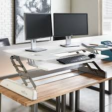 our best ing height adjule solution turns any desk into a standing desk takes you from sitting to standing in just 3 seconds requires no assembly