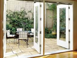 two doors with panes of glass in their centers open onto a terrace