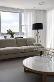 all white furnished spacious livng room remodeling ideas with low marble on top round
