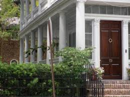 front door opening onto an open porch very much a mon feature in charleston