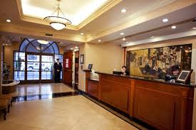 green and stylish front desk hotel interior design of the orchad garden hotel san francisco