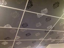 cover ugly drop ceiling panels with textured wallpaper and then spray paint paper and grids decorate drop ceiling panels ceiling panels and