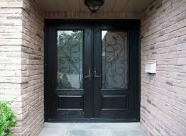 Double Glass Front Doors With Black Wooden Frames Connected By