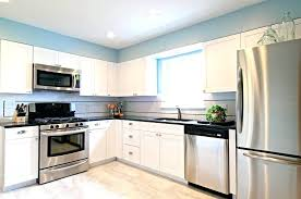 white stainless steel white kitchen cabinets with stainless steel appliances stainless steel watch white face