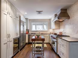 view in gallery rolling kitchen island adds visual excitement to the narrow kitchen layout