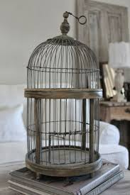 Burlap Luxe - a bird cage that could be used year round with seasonal  plants,