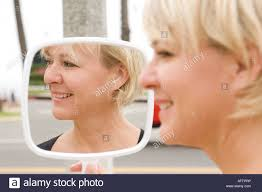 woman holding hand mirror. Mature Woman Holding Hand Mirror, Smiling Mirror