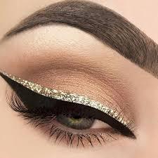 makeup neutral light dark brown eyeshadow with sparkly gold glitter black liquid eyeliner mascara