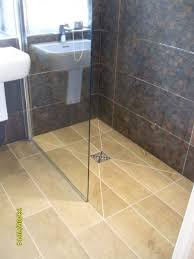 how to use large tiles on a wetroom floor shower area
