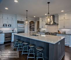 White shaker cabinets with a large kitchen island ...