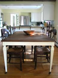 dark stained top white painted legs dining table