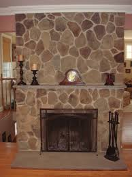 indoor stone fireplace. interior:with gray stone fireplace stones home decor indoor then with