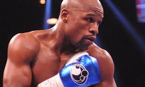 Few sports lean so heavily on the illusion of perfection, and Floyd Mayweather's 'Jr' appendage bolsters the impression that the fighter is ageless and ... - Floyd-Mayweather-Jr-boxer-008