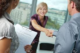 successful job interview happy employee shaking hands smiling stock photo successful job interview happy employee shaking hands smiling focus places on questionnarie in front reults are excellent