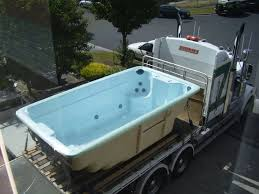 a swim spa being delivered and ready to be installed