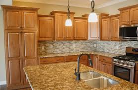 what color granite goes with honey maple cabinets