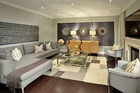 family room decorating ideas. L Shaped Family Room Decorating Ideas With Creative Wall Art And Using Recessed Lighting Plus Sectional Glass Table