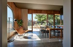 living room chair concrete floor table and floor lighting one of the