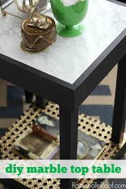chic and small but functional diy marble top table via rainonatinroof com