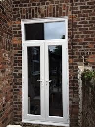 white upvc french doors with fanlight above