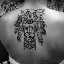 тату лев и череп на спине фото татуировок