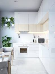 a small modern kitchen nook with cabinets covered light colored wood for giving it textural look