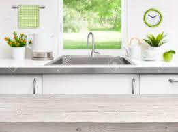 Kitchen Sink Window Wooden Table On Kitchen Sink Window Background Stock Photo