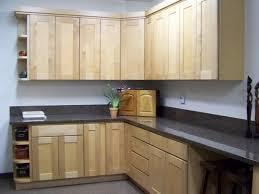 attractive unfinished maple kitchen cabinets with black granite countertop design