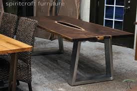 living edge furniture. black walnut and cherry live edge dining table on wooden stainless trapezoid legs at chicago living furniture d