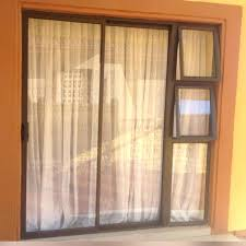 aluminium sliding doors aluminium sliding door with top hung windows all in one trellis aluminium sliding aluminium sliding doors