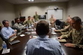 defense secretary ash carter foreground attends a roundtable meeting with army lt gen