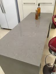 est light dark grey gray quartz kitchen countertops with undermount sink and white cabinet