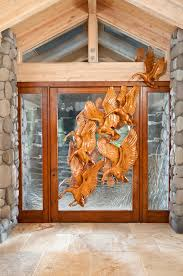 comissioned art kiln carved glass entry door with carved wooden geese