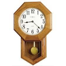 wooden and glass pendulum wall clock