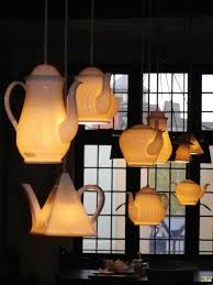 awesome lighting. coffee and tea pots make quirky fun lights for a kitchen or dining room awesome lighting