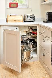 elegant corner cabinets with pullout racks and smart drawers are a popular combination photography