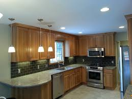 a beautiful new hickory kitchen using pioneer cabinets cambria counters kitchen aid appliances and