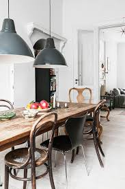Modern Dining Room Pendant Lighting Simple Mismatched Chairs Around A Rustic Modern Table With Industrial