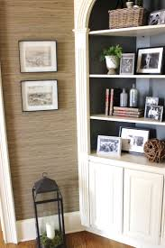 design indulgence: BEFORE AND AFTER OF THE FOYER - love the grasscloth and bookcase  styling