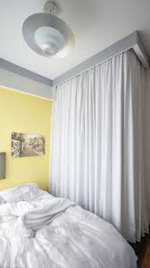Small Bedroom Curtain Tiny Apartment Uses Fabric Curtains To Divide Its Spaces