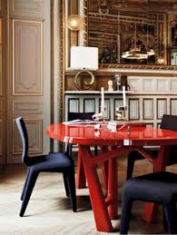 in this apartment in the arrondist in paris the dining room s lacquered oak table is by christophe delcourt and the chairs are by roche bobois
