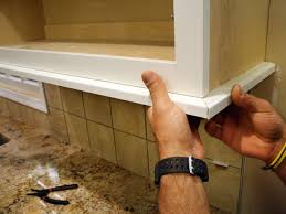 Trim Under Cabinets How To Install A Kitchen Cabinet Light Rail How Tos Diy