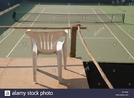 chair facing the empty tennis court pune maharashtra india asia dec 2010 stock image