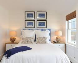 Inspiration for a beach style guest bedroom remodel in New York with white  walls