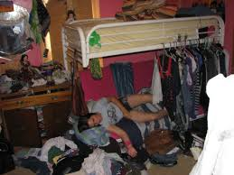pre teen girl lying on unmade bed in messy room stock photo girls messy room essay