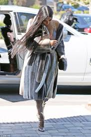 hot mama kim kardashian didn t let the warm weather stop her from rocking